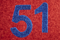 Number fifty-one blue over a red background. Anniversary. Horizontal