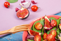 Fruit and vegetable salad with wooden fork, concept of healthy lifestyle and nutrition