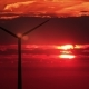 3 Wind Mills Against Red Sunset