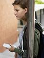 Caucasian student girl standing holding smart phone