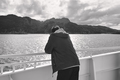 Norway fjord landscape. Young traveler on a cruise. Norwegian tourism. Horizontal