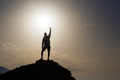 Success with arms outstretched celebrate mountains sunrise