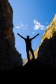 Happy climber reaching life goal success man
