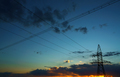 Power lines against the sky at sunset