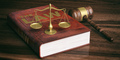 Judge gavel, justice scale and law book on wooden background. 3d illustration