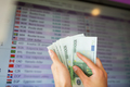 hands with euro money over currency exchange rates