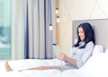 happy businesswoman with tablet pc in hotel room