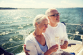 senior couple drinking champagne on sail boat