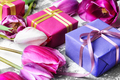 Bouquet of purple tulips and gift box