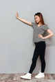 Amazing young asian lady make stop gesture.