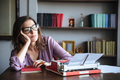 Pensive mature authoress in eyeglasses thinking and looking away