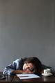 Sleeping woman writer lies indoors
