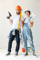 Full-length shot of confident man and woman making repair