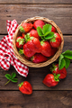 Fresh strawberry in basket on wooden rustic table, closeup