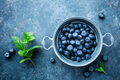 Fresh Blueberries in a bowl on dark background
