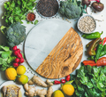 Clean eating healthy cooking ingredients with copy space in center
