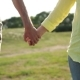 of Seniors Holding Hands Expressing Love