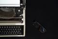 Vintage typewriter on  black background