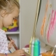 Cute Little Blond Girl Painting with Watercolors