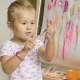Cute Girl Artist Creating a Colorful Abstract