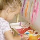 Cute Little Girl Mixing Paints for Her Painting