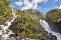 Norwegian twin waterfall. Rocky forest landscape. Latefossen. Visit Norway. Highlight