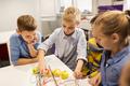children with invention kit at robotics school