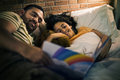 Father reading bed time story with daughter