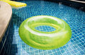 Closeup of inflatable tubes in swimming pool