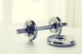 close up of iron dumbbell on table