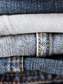 close up of denim clothes or jeans pile