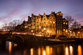 Amsterdam canal houses at dusk