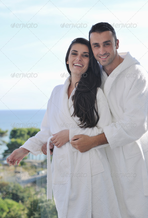 couple relaxing on balcony - Stock Photo - Images