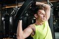 Handsome sportsman make sport exercises in gym