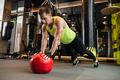 Handsome sportsman make sport exercises in gym.