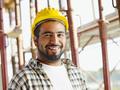 Portrait Of Hispanic Construction Worker In Building Site