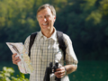 Portrait Of Senior Man Hiking Looking At Camera