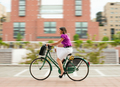 Young Woman Commuting To Job By Bike