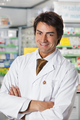 Portrait Of Happy Pharmacist With Arms Crossed Smiling At Camera