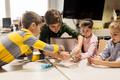 kids with invention kit at robotics school