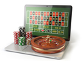 Online roulette casino concept. Laptop with roulette and casino
