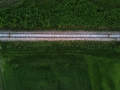 Aerial view of railway track through countryside, drone top view