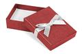 Red decorative present box with white ribbon
