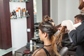 Woman at hairdresser getting a hairstyle