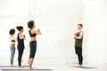 Group of multiethnic people standing in yoga studio
