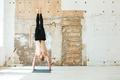 Full length of a man practising yoga poses