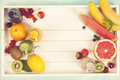 Fresh juices or smoothies with fruits and vegetables in wooden t