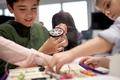 children with building kit at robotics school