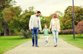 happy family walking in summer park
