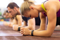 close up of woman at training doing plank in gym